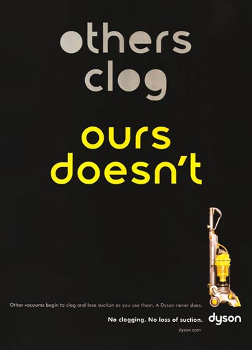 Dyson ad with text, 'Others clog [letters appear clogged], ours doesn't [letters open]'